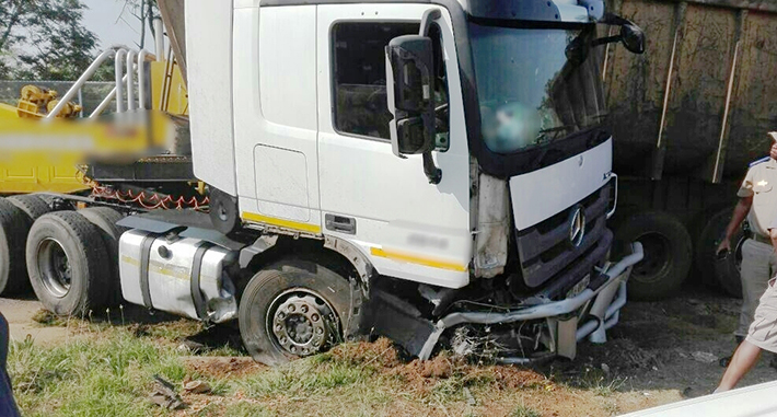 Critical woman airlifted after a large truck crashes into her small car